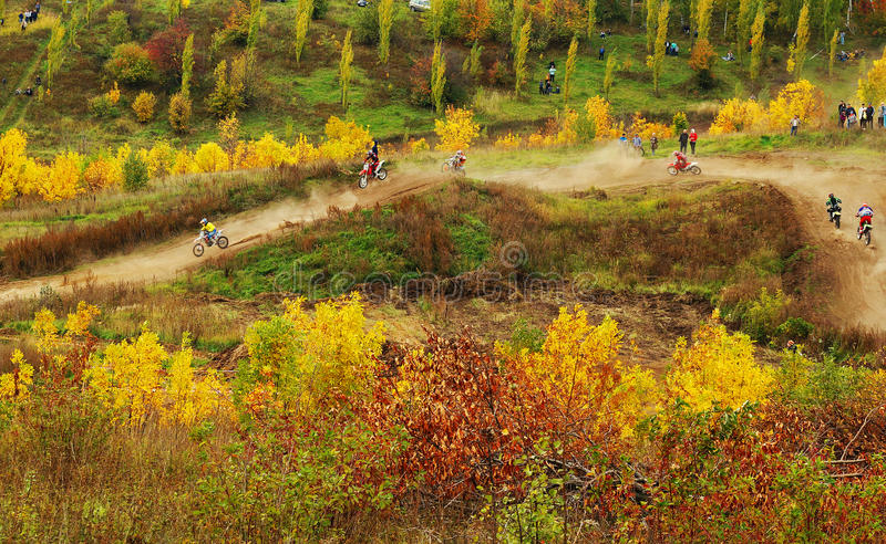 Motocross track. Motocross on the autumn landscape royalty free stock photo