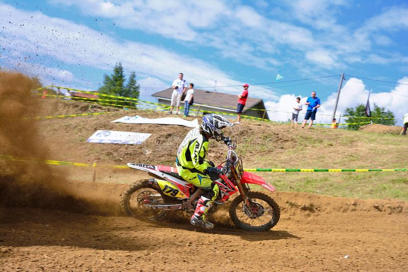 Motocross in Valdesoto, Spain. VALDESOTO, SPAIN - AUGUST 8: Asturias Motocross Championship in August 8, 2015 in Valdesoto, Spain. Miguel Parra rider with the stock images
