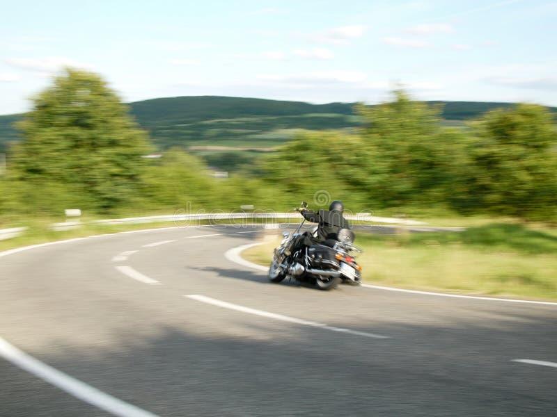 Motocycliste, pris avec la tache floue de mouvement 4 images libres de droits