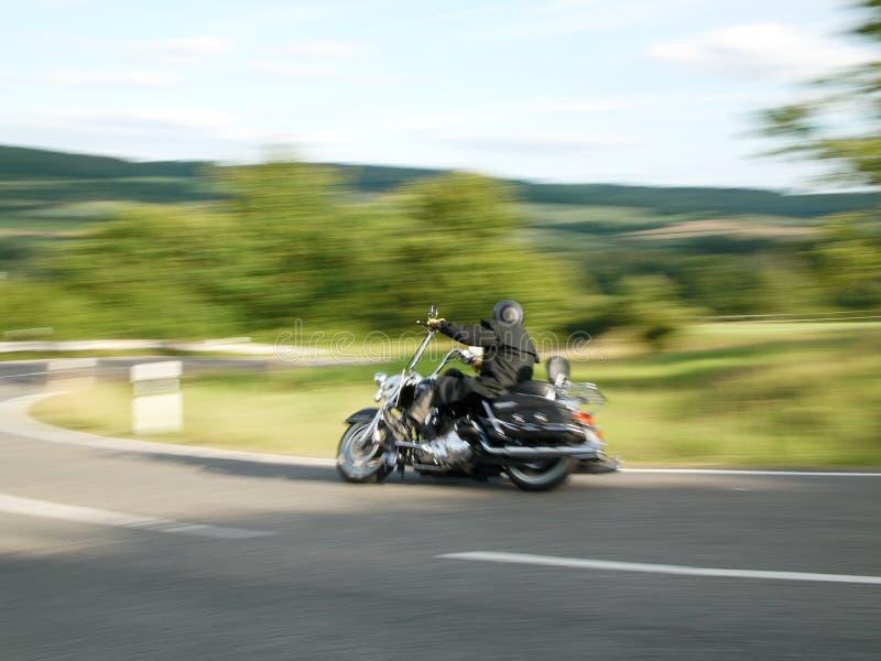 Motocycliste, pris avec la tache floue de mouvement 3 image stock