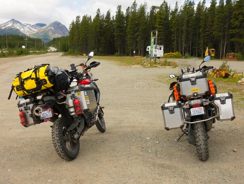 Motor bikes well equipped for a road trip parked at a rest area in northern canada stock photos