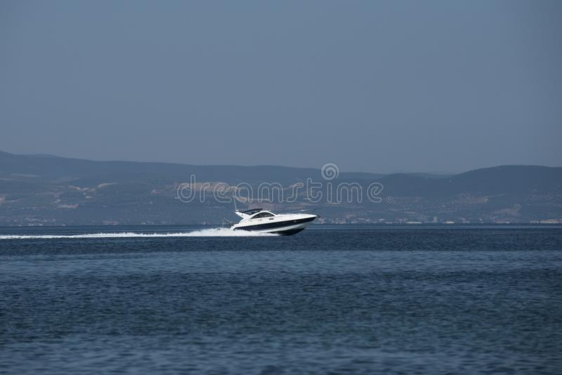 Motor boat speed in sea. Powerboats on sunny seascape. Travel on boat and water transport. Summer vacation on tropical. Island. Power and speed royalty free stock photography