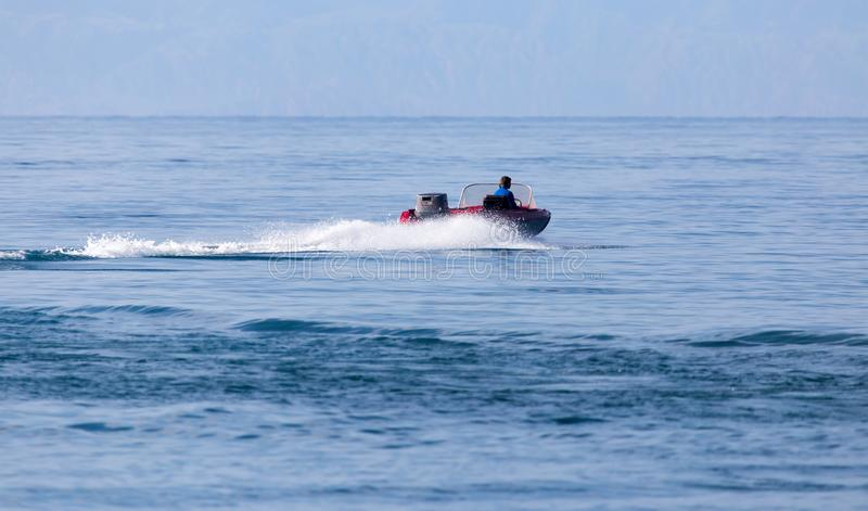Motor boat on the water at a speed of.  stock photos