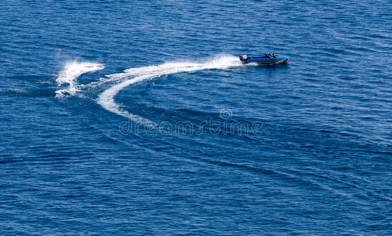 Motor boat on the water at a speed of.  royalty free stock photography
