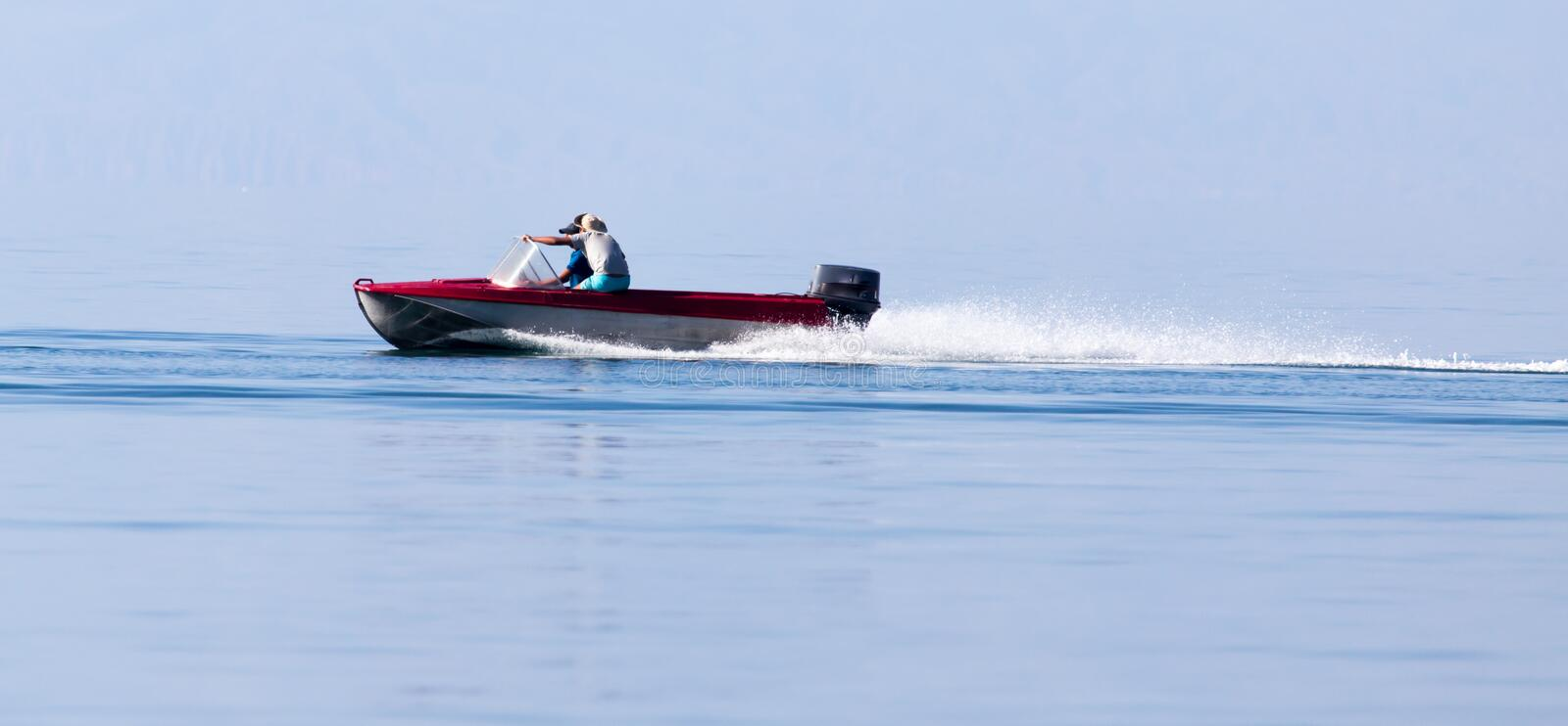 Motor boat on the water at a speed of.  royalty free stock images