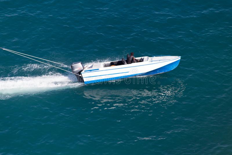 Motor boat on the water at a speed of.  royalty free stock image