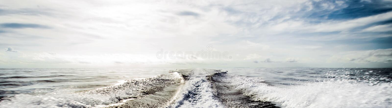 Motor boat water traces in open caribbean sea royalty free stock image