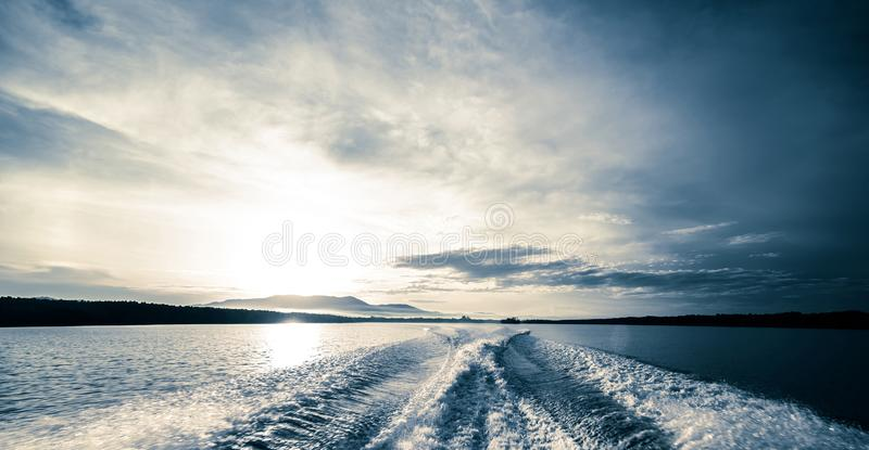 Motor boat water traces in open caribbean sea royalty free stock photography