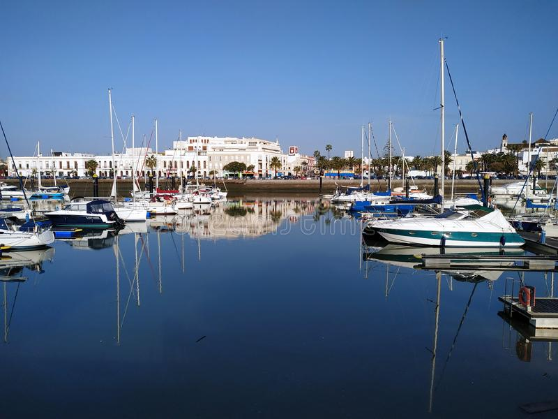 Motor boats moored at the Ayamonte marina. Motor boats moored in the marina Puerto Ayamonte with the buildings of the city in the back, Ayamonte, province of royalty free stock photos