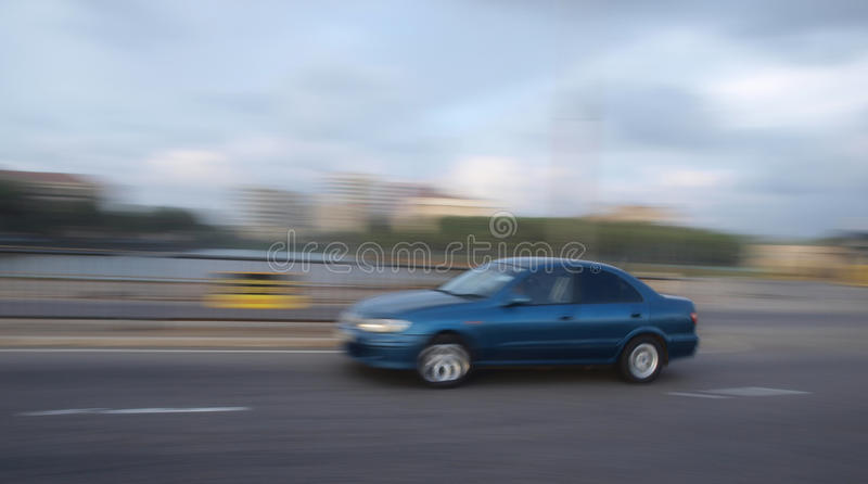 Motor car on the move stock photo