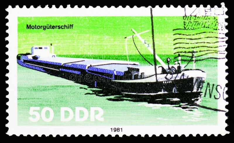Motor cargo ship, Barges serie, circa 1981. MOSCOW, RUSSIA - OCTOBER 6, 2018: A stamp printed in Germany, Democratic Republic shows Motor cargo ship, Barges royalty free stock photo
