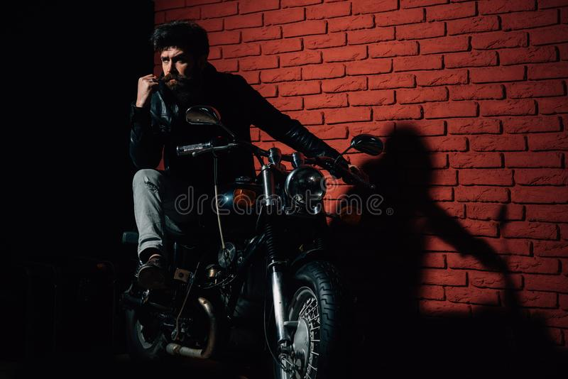 Motor club. motor club or repair shop. hipster man in motor club. biker on motorcycle in motor club. this is my place. Motor club. motor club or repair shop royalty free stock image