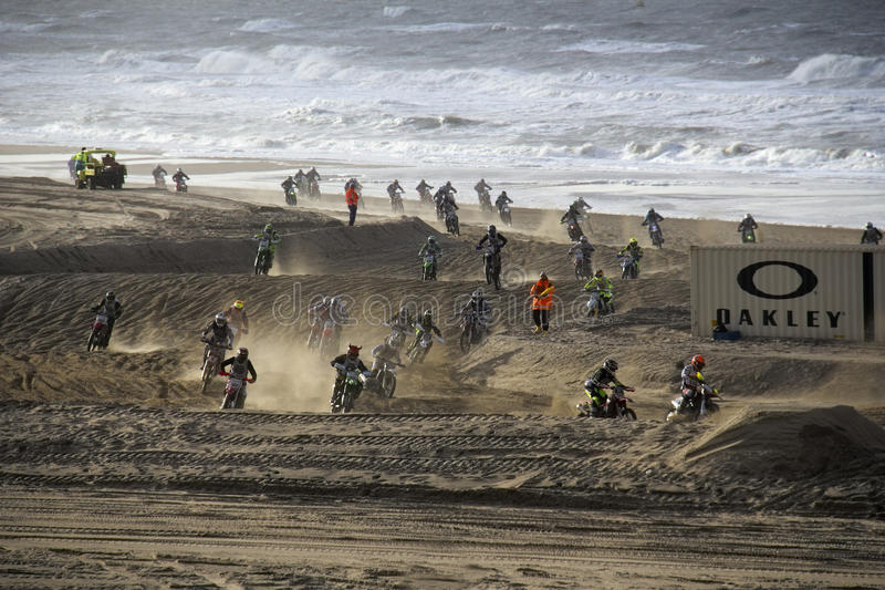 Motor cross race on the Beach. Scheveningen, Holland - November 28, 2015: People participating in the Red Bull Knock Out motocross race on the public beach at stock photos