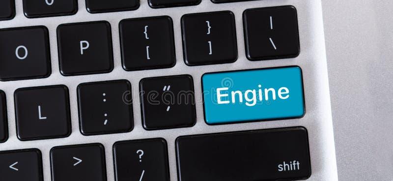 Motor de la palabra en telclado num?rico azul del ordenador port?til del od del bot?n imagenes de archivo