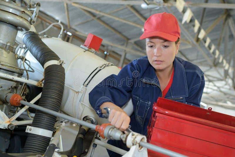 Motor de manutenção do helicóptero do coordenador fotos de stock