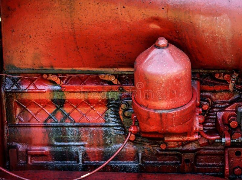 Motor de tractor rojo viejo fotografía de archivo libre de regalías