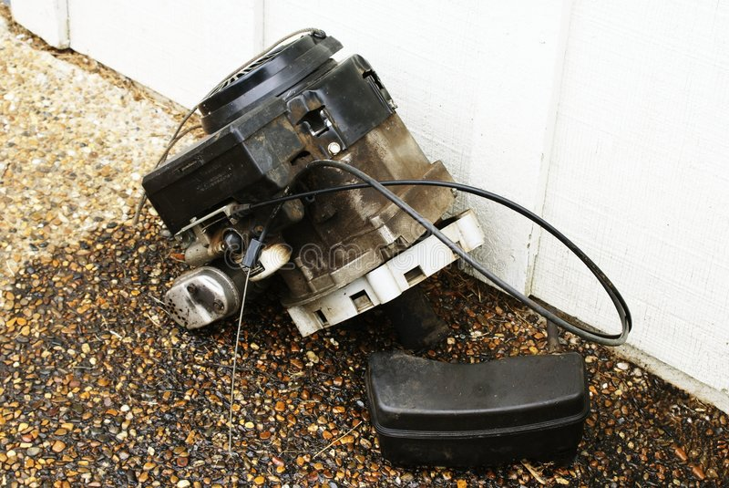 Motor del cortacéspedes de césped imagen de archivo