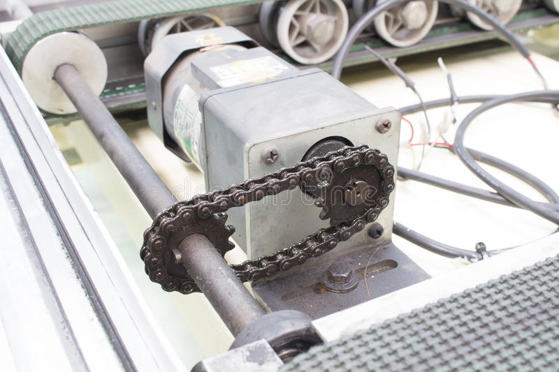 Motor drive shaft and transmission chain, conveyor royalty free stock images