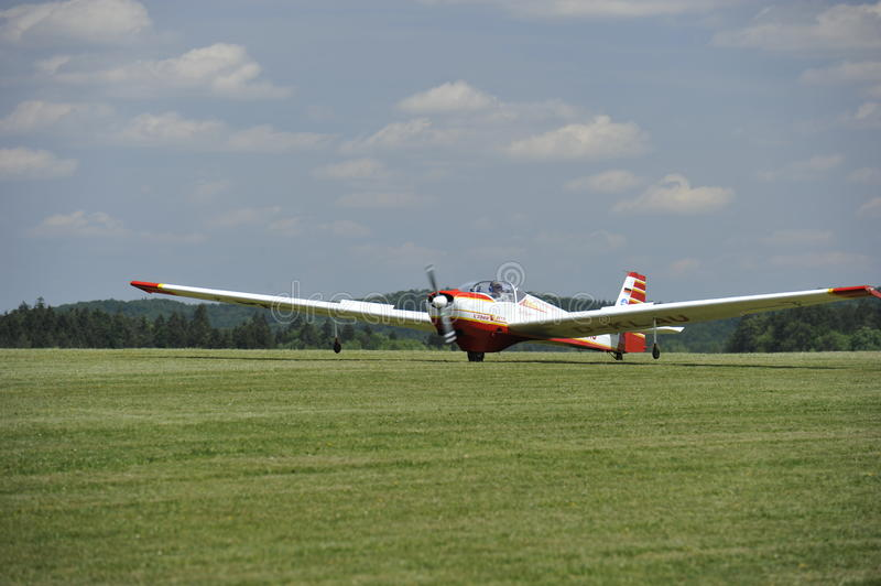 Motor Glider. Starting at a rural airport in Franconia, North-Bavaria, South-Germany. This two seated D-KLAU  was constructed in the year 1990 by manufacturer royalty free stock photography