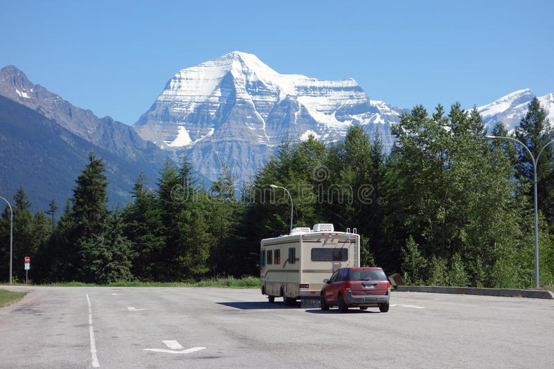 A motor home and dinghy at a national park in alberta stock photos