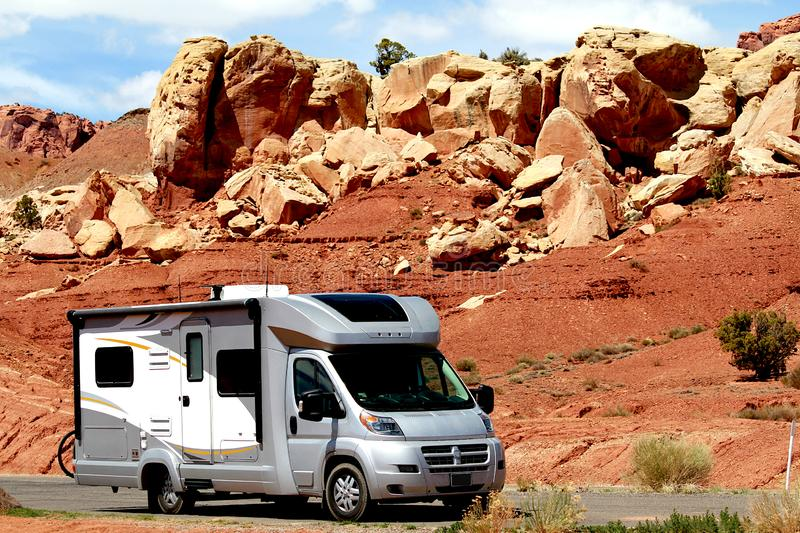 Motor home RV traveling through red rocks in Utah. stock images