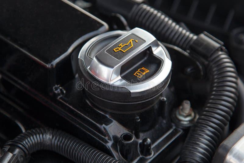 Motor oil cap under the hood of a car stock photo