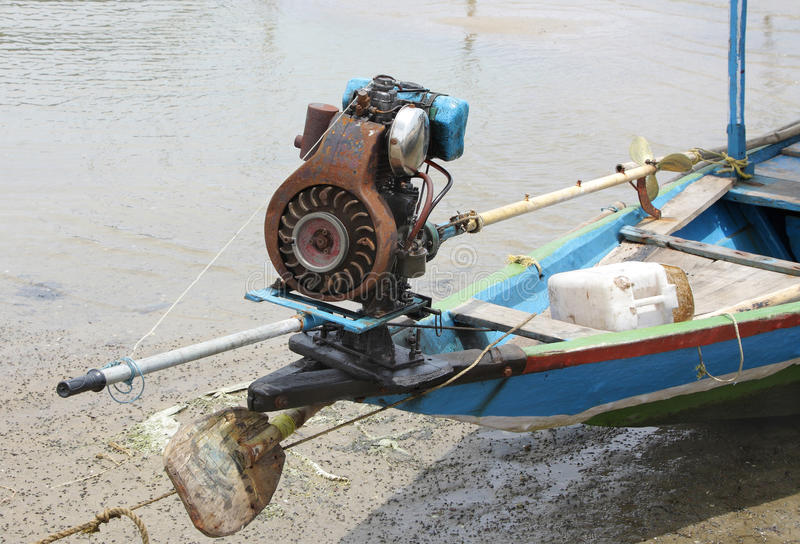 Motor with small propeller in a fishing boat royalty free stock photography