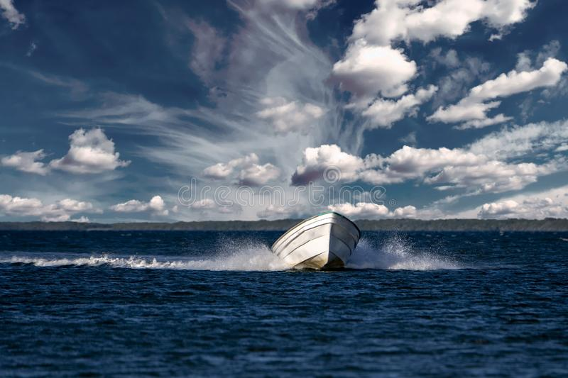 Motor speedboat ship wake. Ship wake in pacific ocean boat cloudy sky background stock photography