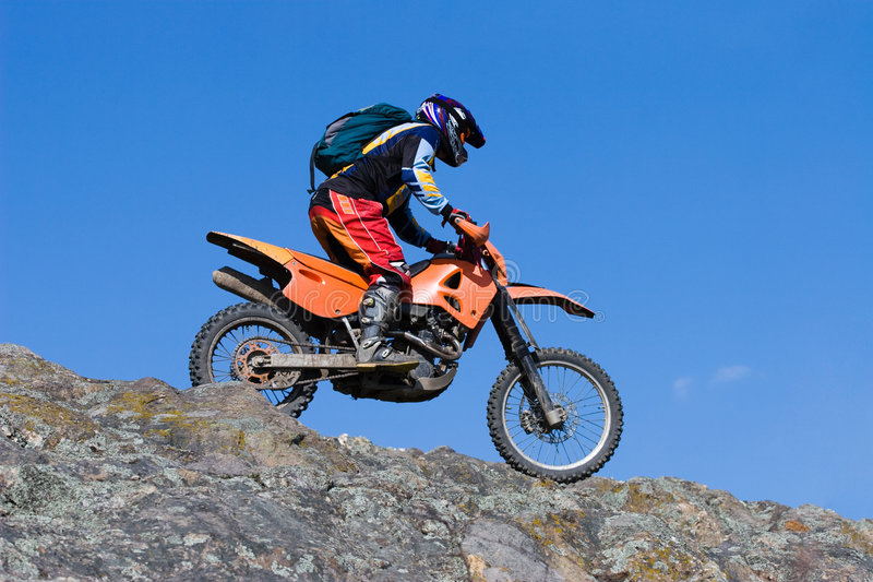 Motor sport. One man riding a motorbike royalty free stock images