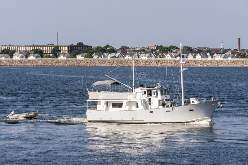 Motor trawler Nobska Light crossing New Bedford outer harbor royalty free stock images