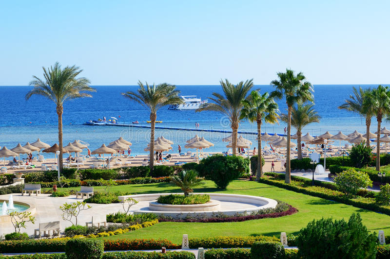 Motor yacht and beach at the luxury hotel stock for Blue sea motor inn