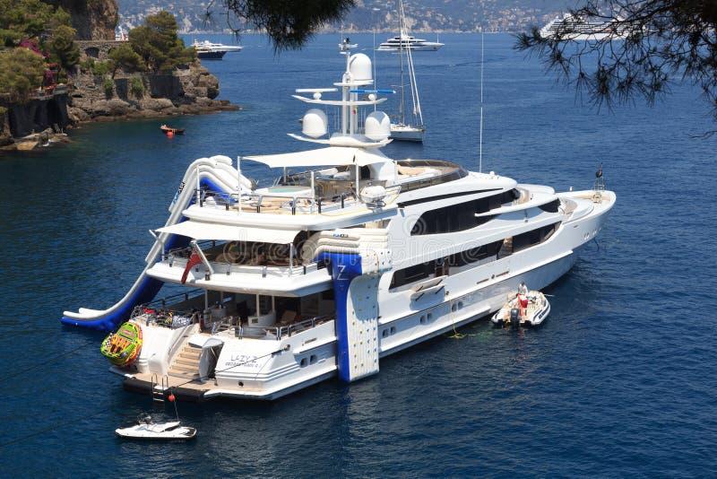 Motor Yacht Lazy Z with watertoys in Portofino stock image