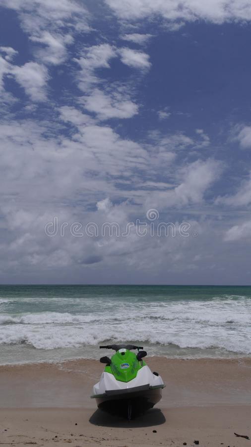 Motorbike on the beach on the background of waves, sea and sky royalty free stock photo