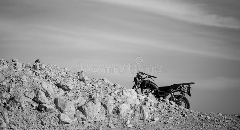 Motorbike. In Desert, Egypt on black and white royalty free stock images