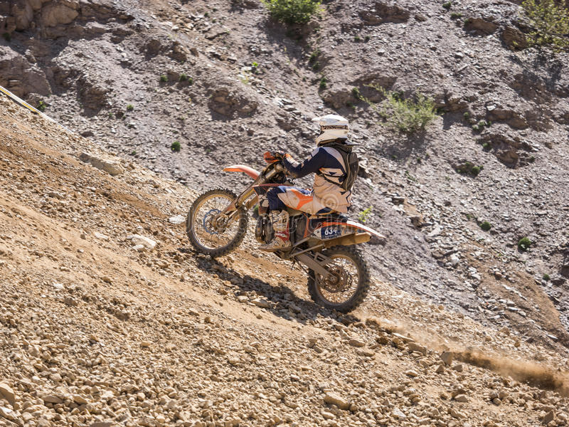 Motorbike driving uphill stock photography