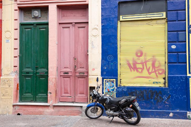 Motorbike in front of colorful houses with doors in green and pink, Le Caminito, La Boca, Buenos Aires, Argentina stock photo