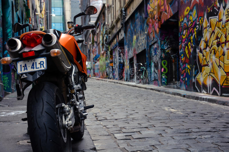 Motorbike in graffiti alley stock images