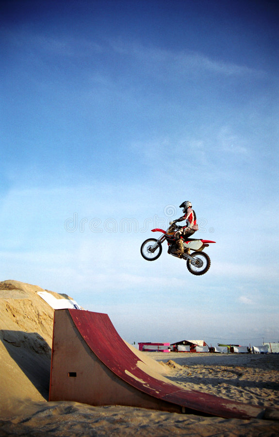 Download Motorbike jump stock photo. Image of sand, obstacle, blue - 1409872