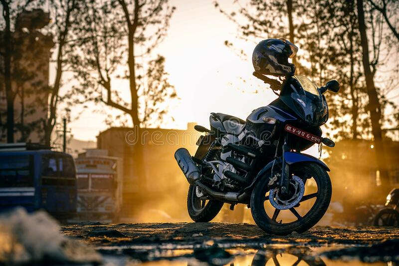 Motorbike parked with helmet stock photography