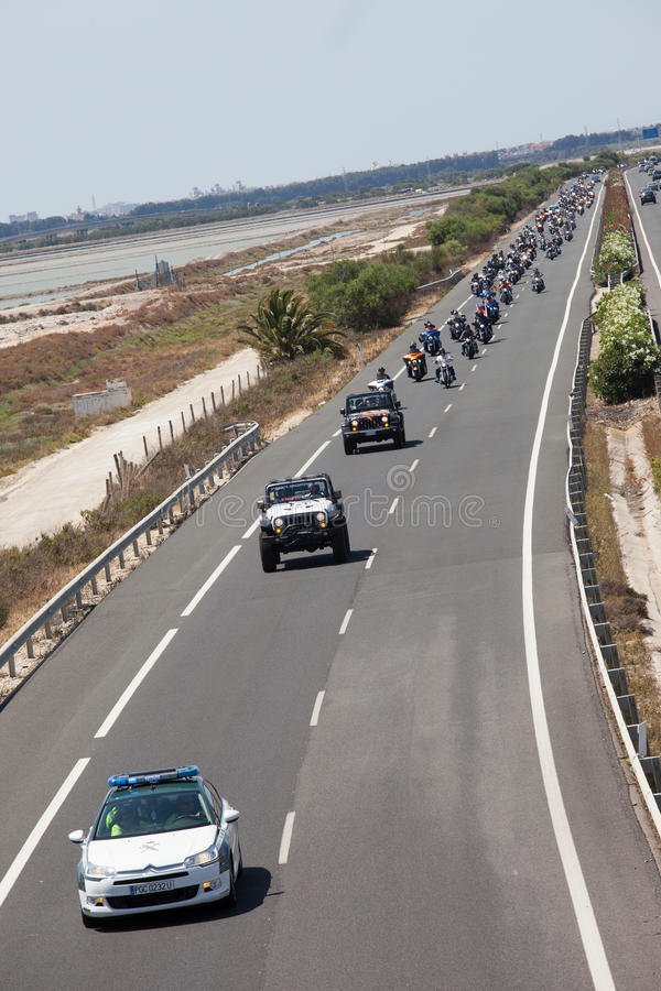 Motorbike procession - Jeeps and Harley in Spain. Harley Davidson annual European meet - this year in Cadiz, Spain. A police escort leads bikes from Cadiz to stock image