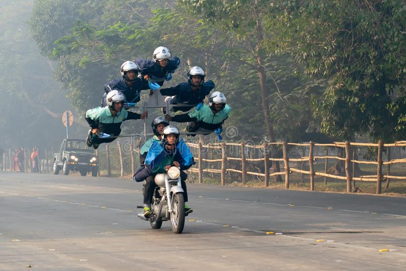 Motorbike rally by Indian Military. RED ROAD, KOLKATA, WEST BENGAL / INDIA - 21ST JANUARY 2018 : Indian army showing their bike riding skills at motorbike rally royalty free stock photography