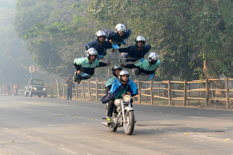 Motorbike rally by Indian Military. RED ROAD, KOLKATA, WEST BENGAL / INDIA - 21ST JANUARY 2018 : Indian miltary men showing their bike riding skills at motorbike stock photos
