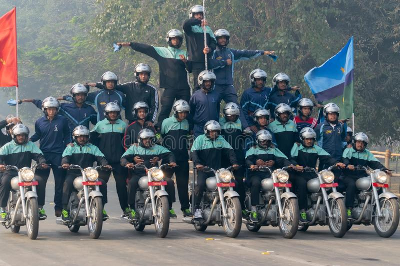 Motorbike rally by Indian Military. RED ROAD, KOLKATA, WEST BENGAL / INDIA - 21ST JANUARY 2018 : Indian miltary men showing their bike riding skills at motorbike royalty free stock photo