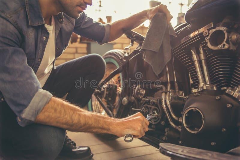 Motorbike repair shop stock photos