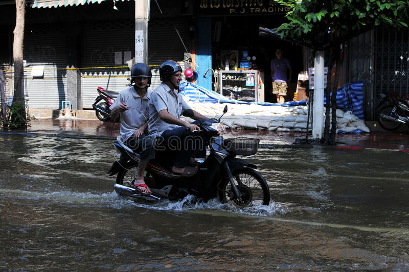Download Motorbike Rider Navigates A Flooded Street Editorial Photo - Image: 24321981