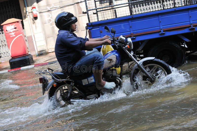 Download Motorbike Rider Navigates A Flooded Street Editorial Image - Image: 24322175