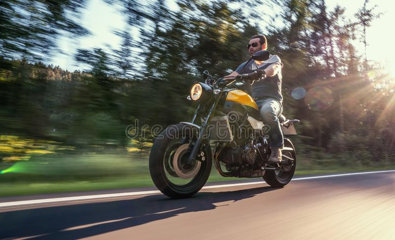 Motorbike on the road driving. having fun riding the empty road on a motorcycle tour / journey royalty free stock photo