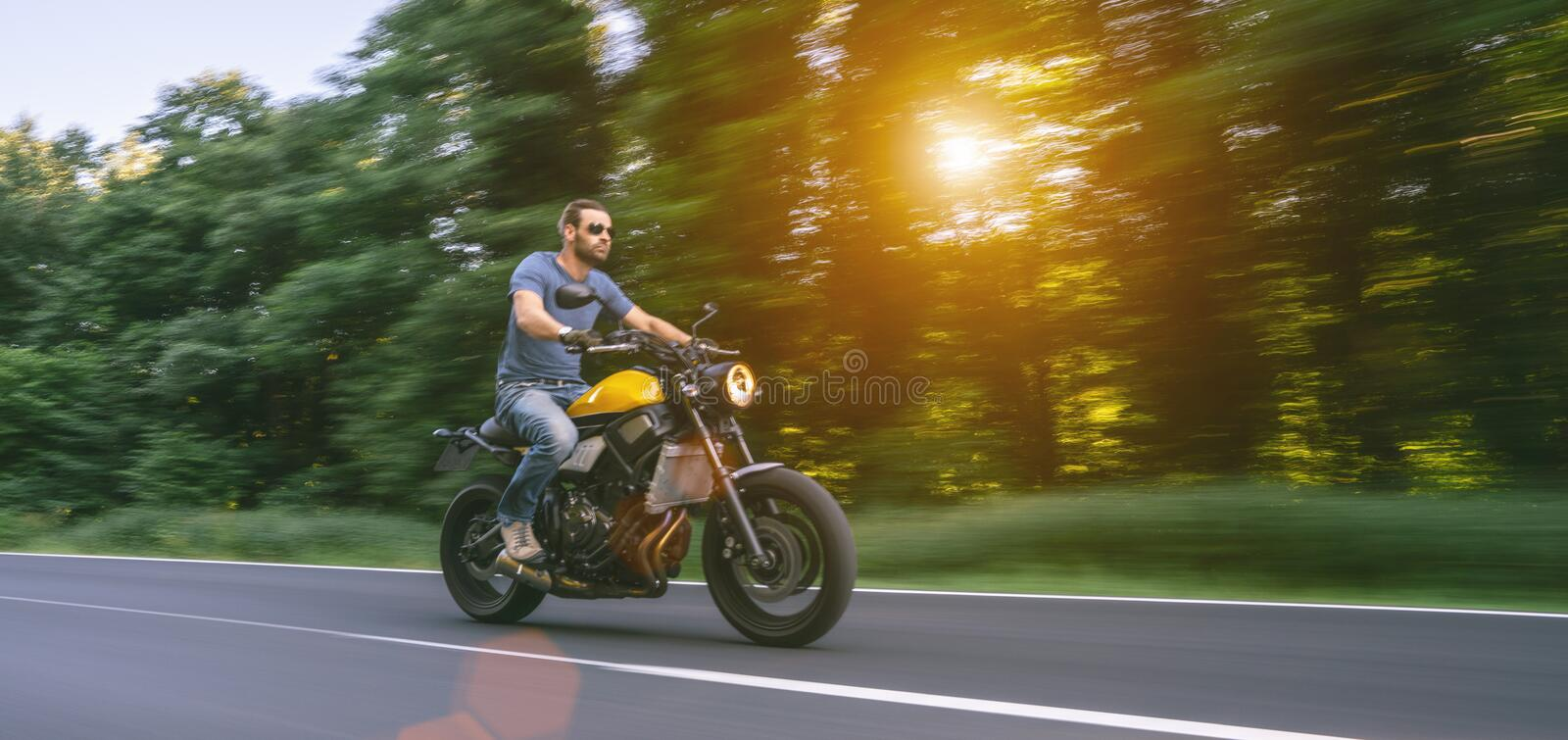 Motorbike on the road riding. having fun riding the empty road on a motorcycle tour / journey royalty free stock images