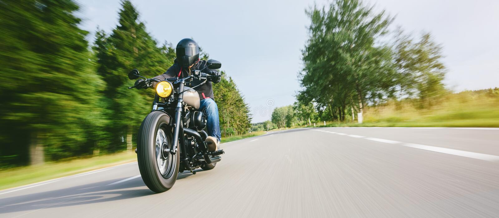 Motorbike on the road riding. having fun riding the empty road on a motorcycle tour / journey royalty free stock image