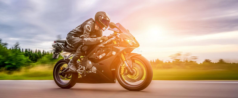 Motorbike on the road riding. having fun riding the empty road o royalty free stock photos